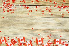 The national holiday of July 1- happy Canada day , Dominion day, the concept of patriotism, independence and memory, a place for. Text. white red confetti and stock images