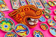 A National house for Mexican fans in Gostiny Dvor. National Souvenirs crafts of the Huichol mosaic of beads. MOSCOW, RUSSIA - June 29, 2018: The 2018 FIFA World stock photography