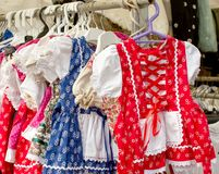 National Hungarian clothes hanging on hangers in the store Royalty Free Stock Image