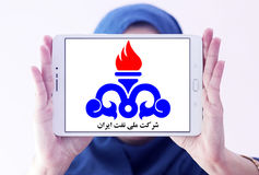 National Iranian Oil Company logo. Logo of the National Iranian Oil Company, NIOC on samsung tablet holded by arab muslim woman Stock Photos