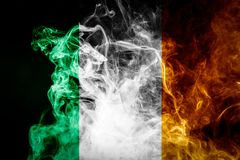 National Ireland flag. Made of thick colored smoke on a black isolated background stock photos
