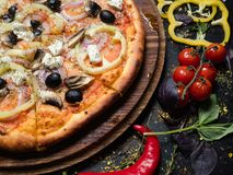 Italian meal homemade pizza food olives pepper. National italian meal. Homemade pizza with olives pepper. Tasty and nutritional food stock images