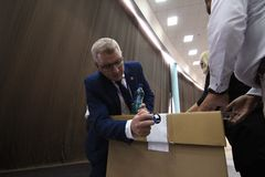 National Liberal Party elections - Romania. Bucharest, Romania - June 17, 2018: Deputy Florin Roman prepares the ballot boxes for the PNL president`s election at stock photo