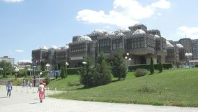 National library of Kosovo Pjeter Bogdani. PRISTINA, KOSOVO - JULY 01, 2015: People walking by entrance of the National library of Kosovo Pjeter Bogdani stock video footage