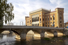 National library. And old bridge in the front, in Sarajevo, capital city of Bosnia and Herzegovina stock image
