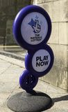A National Lottery sign on the pavement outside a newsagents sho. P in Warrington Cheshire inviting people to come in and play May 2018 Royalty Free Stock Photo