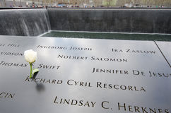 National 9/11 Memorial at Ground Zero. A white rose is left beside the name of Richard Cyril Rescorla one of the heroes of the aftermath of the 9/11 terrorist Stock Photo