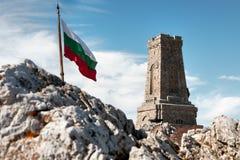 National memorial monument on Shipka peak. Bulgaria and waving Bulgarian flag Stock Image