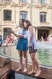 A National Mexican Celebration of the Day of the Dead. Two girls soaked through in the fountain take selfie. MOSCOW, RUSSIA - June 29, 2018: The 2018 FIFA World royalty free stock images