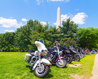 National Monument and multi-colored motorbikes. Stock Image