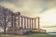 National Monument of Scotland, on Calton Hill in Edinburgh, Scot. Land, UK during Spring Time, toned image Royalty Free Stock Image