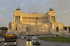 National Monument to Victor Emmanuel II iluminated by sunset. Stock Image