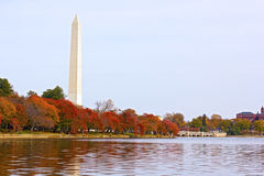 National Monument with trees around the Tidal Basin in autumn foliage. Stock Photo