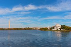 National Monument in Washington DC, US capital. Washington Monument stands above US flags under a blue sky Stock Images