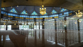 National Mosque Kuala Lumpur. Modern Interior of the National Mosque in the Kuala Lumpur Malaysia. Beautifully decorated in the islamic style. Colored mosaic at Stock Photo
