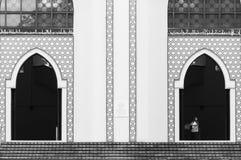 National Mosque of Malaysia. A muslim woman exits the National Mosque of Malaysia on December 27, 2013 in Kuala Lumpur, Malaysia Royalty Free Stock Images