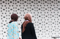 National Mosque of Malaysia. Muslim women exit the National Mosque of Malaysia on December 27, 2013 in Kuala Lumpur, Malaysia Royalty Free Stock Images