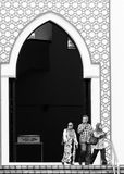 National Mosque of Malaysia. Muslims exit the National Mosque of Malaysia on December 27, 2013 in Kuala Lumpur, Malaysia Stock Image