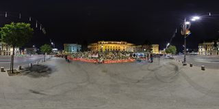 National Mourning after the decease of Michael I at the Royal Palace in Bucharest, Romania. 360 panorama of Piata Revolutiei at night with Heaps of flowers Stock Photography