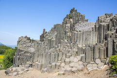 National Natural Monument named Panska skala, columnar jointed basalt rock in Kamenicky senov village in Czech republic. Tourist attraction, sunny day and blue stock images