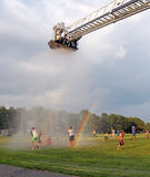 National Night Out. Water coming out  from the fire truck helped children to cool off and have fun in a hot summer day as part of National Night  event out in Stock Photos