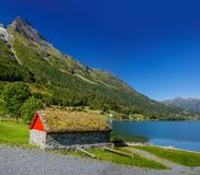National Norwegian small house with a grass on a roof Royalty Free Stock Photography