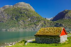 National Norwegian small house with a grass on a roof Royalty Free Stock Photo