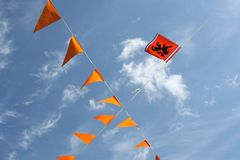 National orange flags with Dutch lion at Kingsday (Koningsdag), Holland. National orange flags with the Dutch lion and red, white, blue in the Netherlands. These Royalty Free Stock Photo