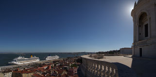 National Pantheon dome profile over tagus river and alfama. National Pantheon dome profile and balcony extending over the Tagus river, Santa Apolonia, Alfama Royalty Free Stock Photos
