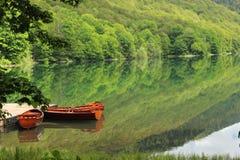 Biogradska Gora lake with two boats. National park Biogradska Gora and lake with two boats in Montenegro stock photography