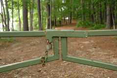 National park closed gate pathway to nature. Pad locked gate closing a National park pathway to a nature trail. Signs of hard economic times in the United States Royalty Free Stock Photos