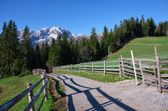 National park Durmitor in the Montenegro. Mountains in the snow and road with fence. Royalty Free Stock Photography
