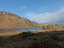 National Park Ireland Gougane Barra Irish rocky and lake landscape. With blue skies royalty free stock photography