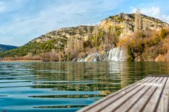 National park Krka, the waterfall land. One of many waterfalls in National park Krka. This one is flows into natural lake formed on the river, that is Royalty Free Stock Image