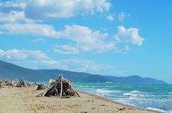 National park Maremma. Maremma national park with the sunscreen built of driftwood Stock Images