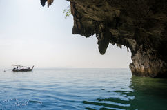National Park in Phang Nga Bay with tourist boat Royalty Free Stock Images