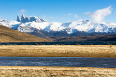 The National Park Torres del Paine, Patagonia, Chile. A blue lake with snow mountains in the background in The National Park Torres del Paine, Patagonia, Chile Royalty Free Stock Photo