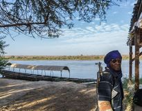 A security guard patrolling on the niger river, niger, west africa stock images
