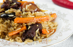National pilau rice with beef served on a round plate stock photos