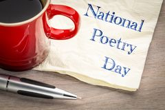 National Poetry Day. Handwriting on a napkin with a cup of coffee royalty free stock image