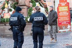 National police patrol in the pedestrian street at the christmas market. Mulhouse - France - 9 December 2018 - national police patrol in the pedestrian street at royalty free stock image