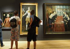 National Portrait Gallery, London. Modern teens admiring Tudor finery, National Portrait Gallery, London, 2013 Royalty Free Stock Images