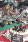 NATIONAL PRESS DAY CAKE CHILD TOGETHER Stock Image
