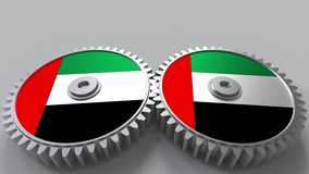 National project flags of the United Arab Emirates UAE on moving cogwheels. National project. Flags of the United Arab Emirates UAE on moving cogwheels stock video footage