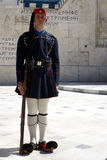 National proud. Greek soldier in traditional army uniform in Constitution square (War memorial) - Athens , Greece Stock Images