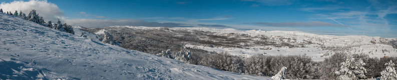 Plateau in winter. National Reserve of Ukraine. A wonderful sunny day on Mount Ai-Petri. In winter, visitors register for the remainder is the place running a Stock Images