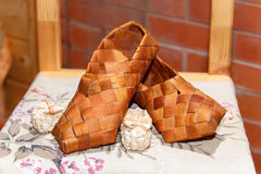 National Russian bast shoes on brick background Stock Photo