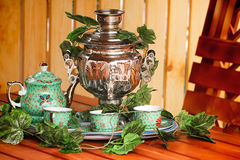 National Russian tradition to drink tea from a samovar. Royalty Free Stock Photo
