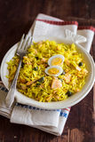 National scottish dish kedgeree with roasted basmati rice, curry powder and fish in a plate Royalty Free Stock Photo