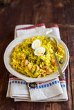 National scottish dish kedgeree with roasted basmati rice, curry powder and fish in a plate Royalty Free Stock Image